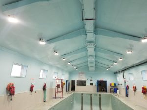 New energy efficient LED lighting at a community pool installed by Half Diamond R Electric